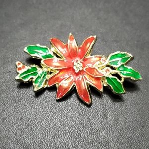 Vintage gold tone poinsettia brooch